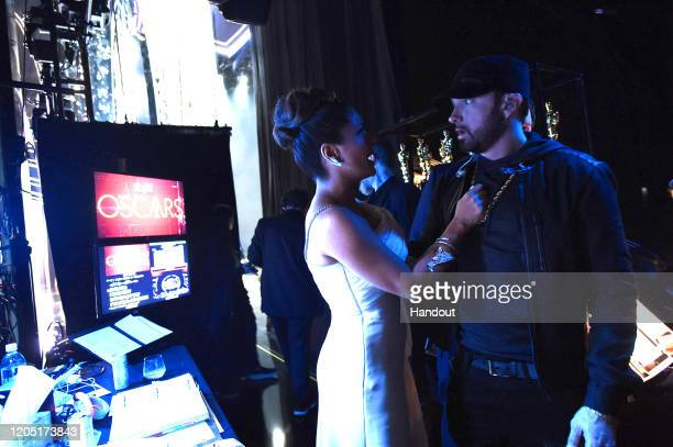 In this handout photo provided by AMPAS Salma Hayek Pinault and Eminem pose backstage during the 92nd Annual Academy Awards at the Dolby Theatre on...