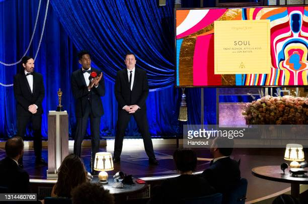 In this handout photo provided by A.M.P.A.S., Trent Reznor, Jon Batiste, and Atticus Ross accept the Music award for 'Soul' onstage during the 93rd...
