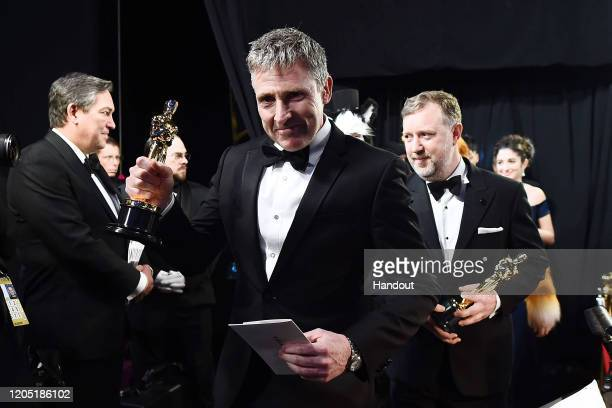 In this handout photo provided by AMPAS Visual Effects award winners Dominic Tuohy and Greg Butler walk backstage during the 92nd Annual Academy...