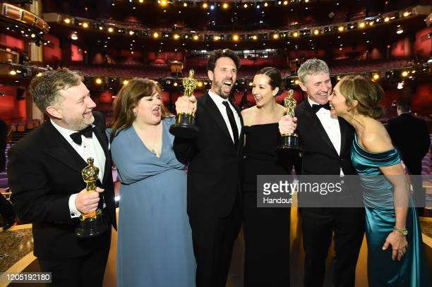 In this handout photo provided by AMPAS Visual Effects award winners Greg Butler Guillaume Rocheron and Dominic Tuohy pose onstage during the 92nd...