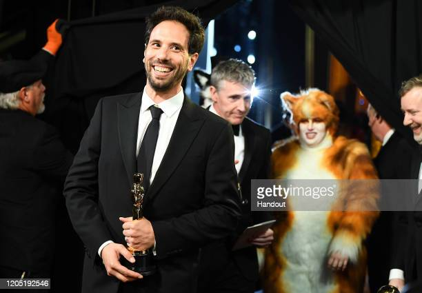 In this handout photo provided by AMPAS Visual Effects award winners Guillaume Rocheron and Dominic Tuohy walk backstage during the 92nd Annual...