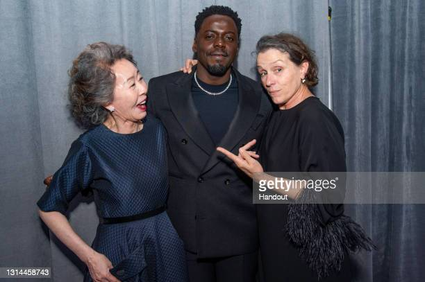 """In this handout photo provided by A.M.P.A.S. Yuh-Jung Youn, winner of Best Actress in a Supporting Role for """"Minari,"""" Daniel Kaluuya, winner of Best..."""