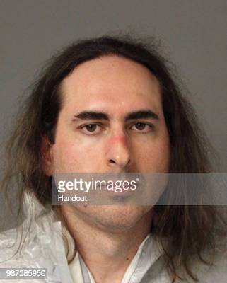 In this handout photo provided by Anne Arundel County Police Jarrod W Ramos poses for his mugshot after his arrest on June 28 2018 in Annapolis...