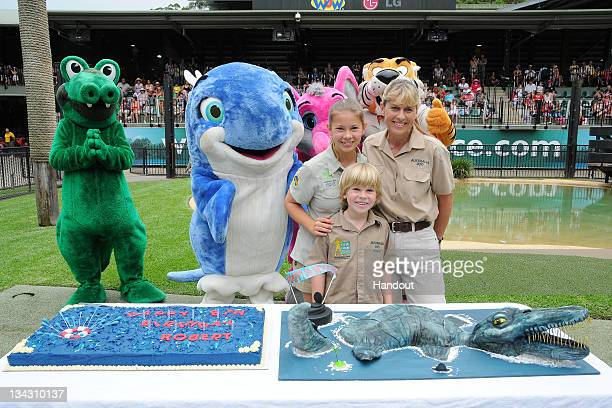 In this handout photo provided by Australia Zoo Robert Irwin celebrates his eighth birthday with sister Bindi and mother Terri Irwin at Australia Zoo...