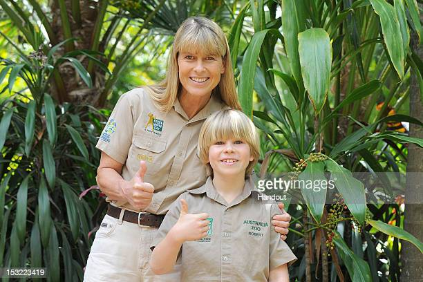 In this handout photo provided by Australia Zoo Terri Irwin and her son Robert Irwin pose for a photo after Robert feed freshwater crocodiles for the...