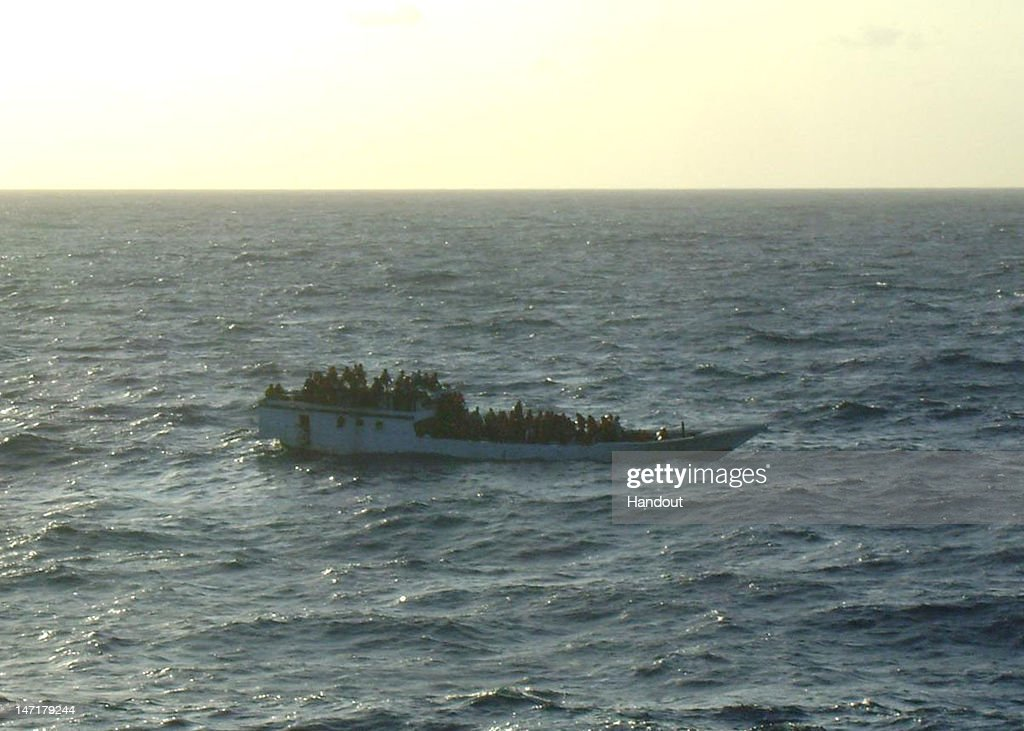 In this handout photo provided by Australian Maritime Safety Authority, a boat carrying 150 suspected asylum seekers is spotted by crew onboard MV Bison, prior to the vessel sinking, at sea 107 nautical miles north of Christmas Island, on June 27, 2012. The Royal Australian Navy is sending HMAS Maitland and HMAS Leeuwin to assist two merchant vessels with the rescue effort, and an RAAF P3 Orion is expected to be on the scene shortly. Last Thursday a boat capsized off the coast of Christmas Island, with more than 90 people still missing, expected drowned.