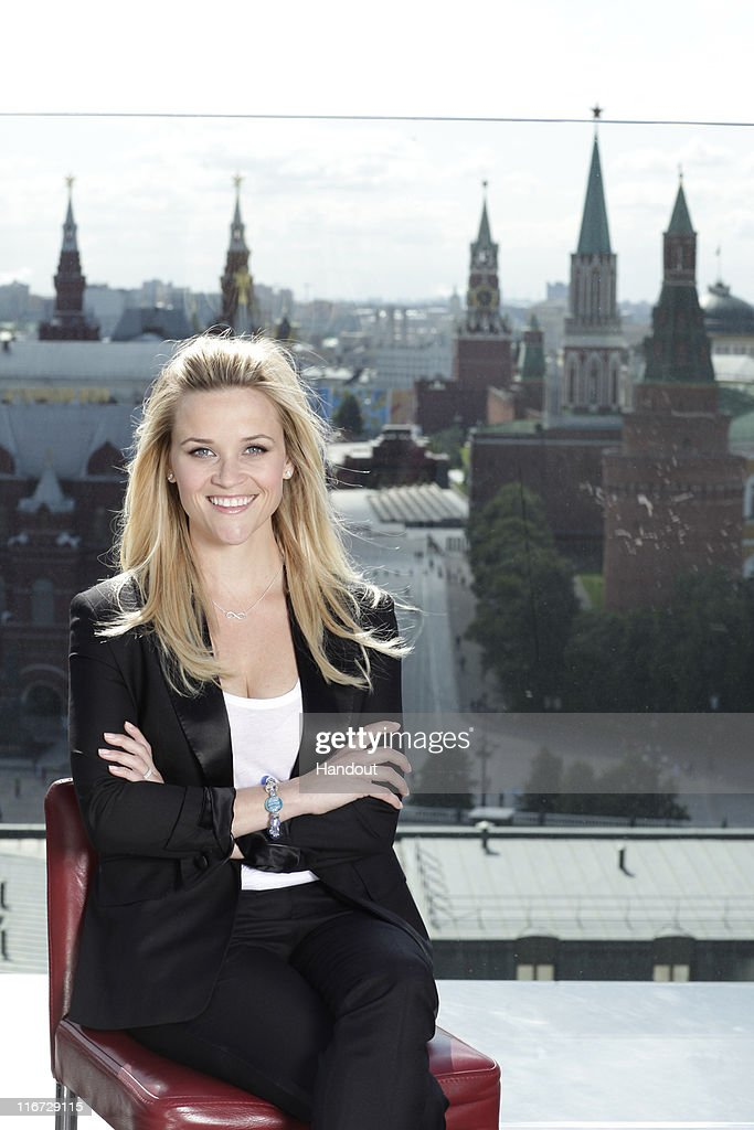In this handout photo provided by Avon, Avon Global Ambassador Reese Witherspoon wears Avon's Empowerment bracelet and necklace as she helps celebrate the Company's 125th Anniversary at the Believe World Tour on June 17, 2011 in Red Square Moscow, Russia.