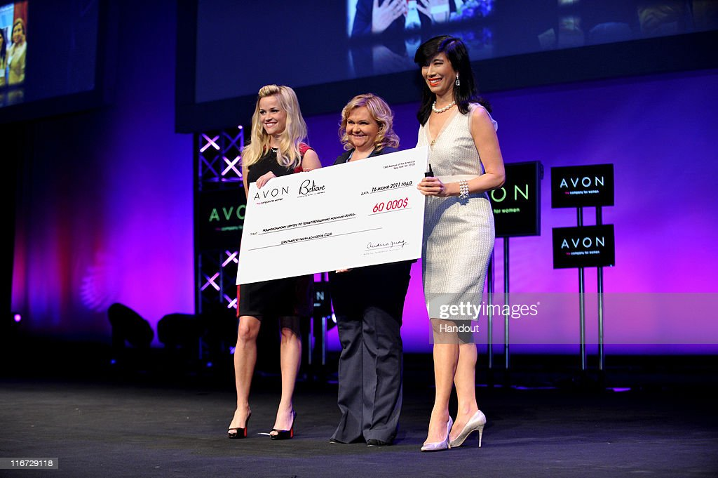 In this handout photo provided by Avon, Avon Global Ambassador Reese Witherspoon and Avon Chairman and CEO Andrea Jung present Russian domestic violence organization ANNA's General Director Marina Pisklakova-Parker with a $60,000 grant as part of the Avon Global Believe Fund on June 16, 2011 in Moscow, Russia.