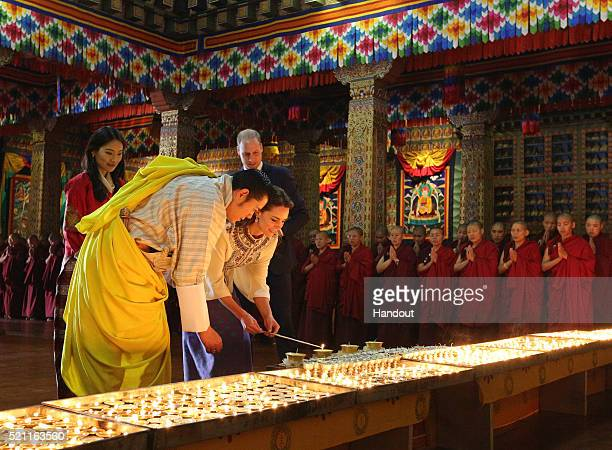 In this handout photo provided by Bhutan Royal Office Prince William Duke of Cambridge and Catherine Duchess of Cambridge pose with King Jigme Khesar...