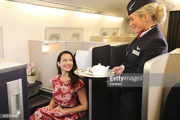 In this handout photo provided by British Airways Sex and the City star Kristin Davis enjoys a cup of tea served on board British Airways' First...