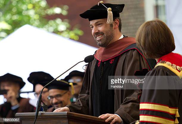 In this handout photo provided by Brown University actor/director Ben Affleck receives an honorary Doctor of Fine Arts degree from Brown University...