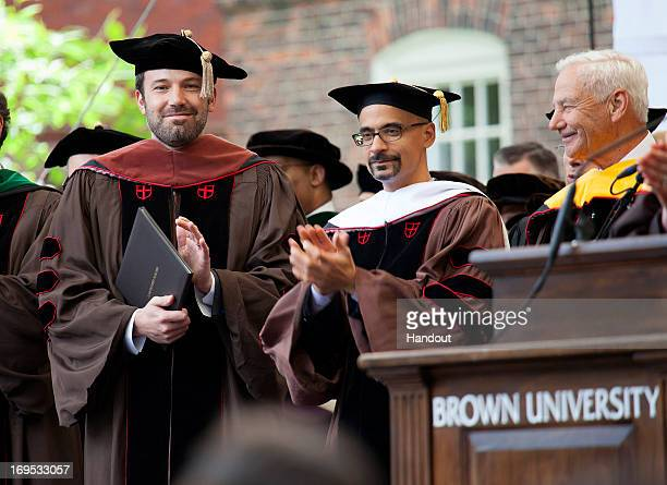 In this handout photo provided by Brown University, actor/director Ben Affleck receives an honorary Doctor of Fine Arts degree from Brown University...