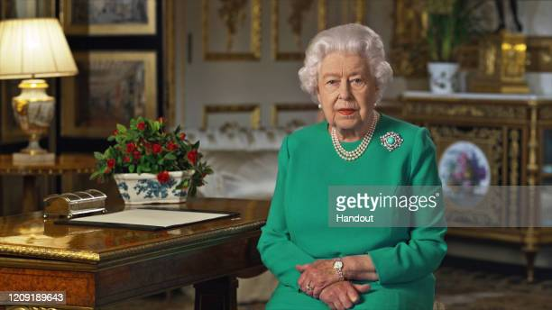 In this handout photo provided by Buckingham Palace, Queen Elizabeth II addresses the nation in a special broadcast to the United Kingdom and the...