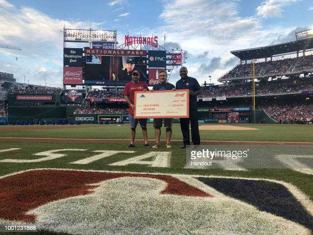 In this handout photo provided by Budweiser to celebrate Budweiser and Folds of Honors continued partnership Ricardo Marques of Budweiser presents a...