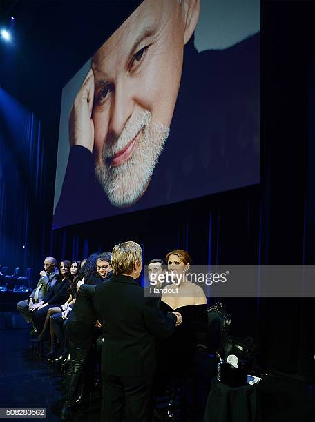 In this handout photo provided by Caesars Palace Patrick Angelil ReneCharles Angelil and Celine Dion recieves condolences from friends during Rene...