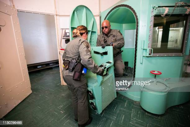 In this handout photo provided by California Department of Corrections and Rehabilitation staff members dismantle the death row gas chamber at San...