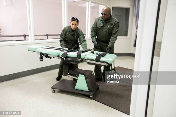 In this handout photo provided by California Department of Corrections and Rehabilitation staff members dismantle the death row lethal injection...