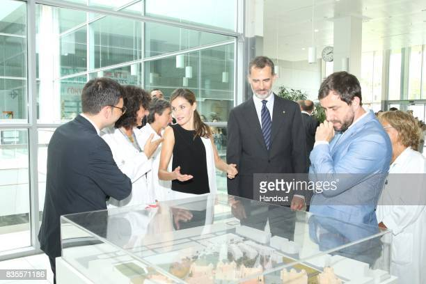 In this handout photo provided by Casa de SM el Rey de Espana King Felipe VI of Spain and Queen Letizia of Spain meets with medical staff as they...