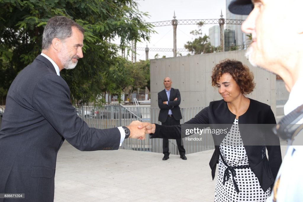 In this handout photo provided by Casa de S.M. el Rey de Espana, King Felipe VI of Spain meets with medical staff as they arrive to visit last Thursday's terrorist attack victims at the Hospital de la Santa Creu i Sant Pau on August 19, 2017 in Barcelona, Spain. Thirteen people were killed and dozens injured in the Las Ramblas area of Barcelona when a van hit crowds on August 17.