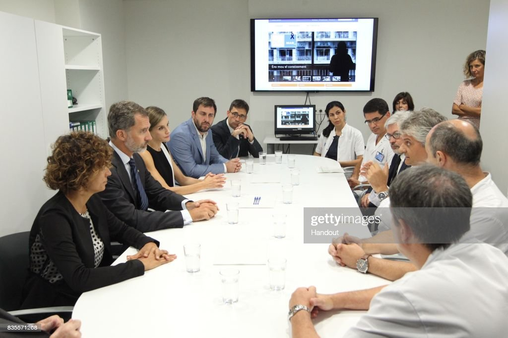 In this handout photo provided by Casa de S.M. el Rey de Espana, King Felipe VI of Spain and Queen Letizia of Spain speak with medical staff before they visit last Thursday's terrorist attack victims at the Hospital de la Santa Creu i Sant Pau on August 19, 2017 in Barcelona, Spain. Thirteen people were killed and dozens injured in the Las Ramblas area of Barcelona when a van hit crowds on August 17.