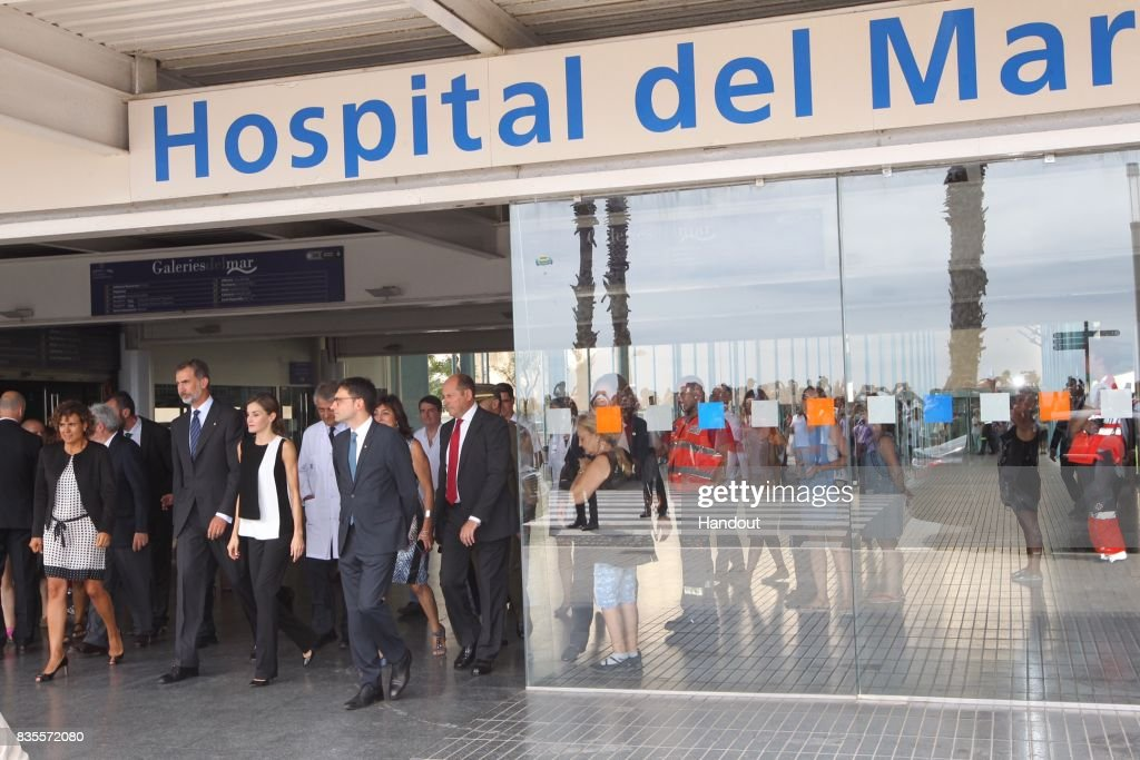 In this handout photo provided by Casa de S.M. el Rey de Espana, King Felipe VI of Spain and Queen Letizia of Spain walk with medical staff after hey visited last Thursday's terrorist attack victims at the Hospital de la Santa Creu i Sant Pau on August 19, 2017 in Barcelona, Spain. Thirteen people were killed and dozens injured in the Las Ramblas area of Barcelona when a van hit crowds on August 17.