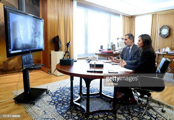 In this handout photo provided by Casa de SM el Rey Spanish Royal Household King Felipe of Spain and Queen Letizia of Spain take part in a video...