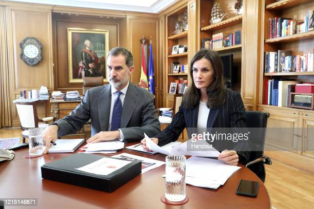 In this handout photo provided by Casa de S.M. El Rey Spanish Royal Household, King Felipe of Spain and Queen Letizia of Spain take part in a video...