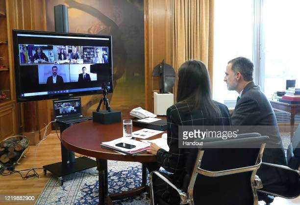 In this handout photo provided by Casa de SM el Rey Spanish Royal Household King Felipe VI of Spain and Queen Letizia of Spain take part in a video...