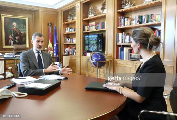 In this handout photo provided by Casa de SM el Rey Spanish Royal Household King Felipe VI of Spain receives Minister of Labour and Social Economy...