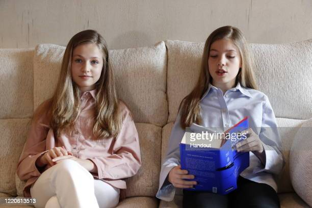 In this handout photo provided by Casa de SM el Rey Spanish Royal Household Princess Leonor of Spain and Princess Sofia of Spain read El Quijote book...