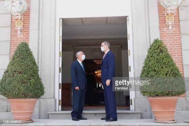 In this handout photo provided by Casa de S.M. El Rey Spanish Royal Household, King Felipe VI of Spain recieves Portuguese President Marcelo Rebelo...