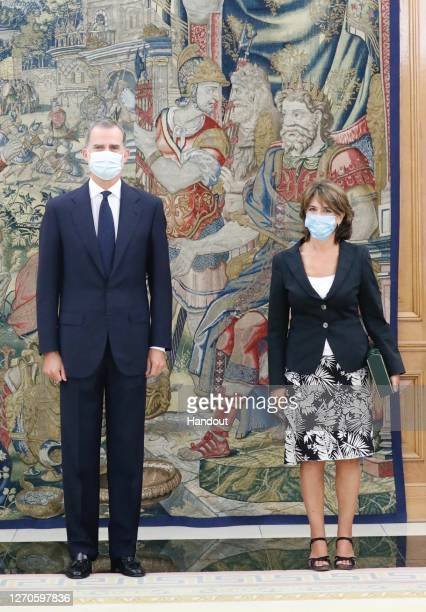 In this handout photo provided by Casa de S.M. El Rey Spanish Royal Household, King Felipe VI of Spain receives Attorney General of the State Dolores...