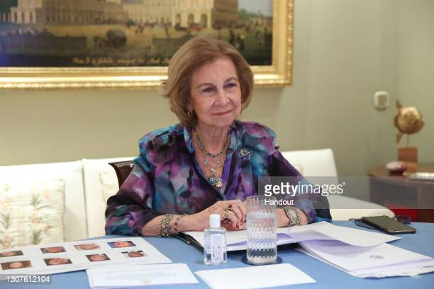 In this handout photo provided by Casa de S.M. El Rey Spanish Royal Household, Queen Sofia takes part in a video conference with members of 'Queen...