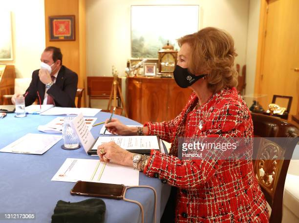 In this handout photo provided by Casa de S.M. El Rey Spanish Royal Household, Queen Sofia takes part in a video conference with members of 'Spanish...