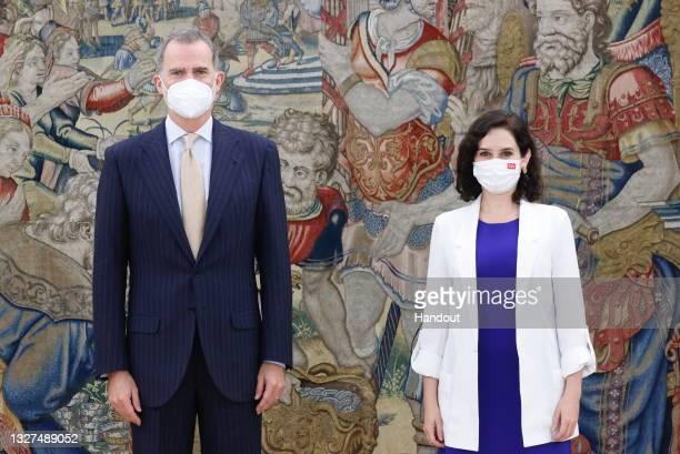 In this handout photo provided by Casa de S.M. El Rey Spanish Royal Household, King Felipe VI of Spain receives Madrid Regional President Isabel Diaz...