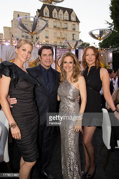 In this handout photo provided by Church of Scientology Jenna Elfman John Travolta Kelly Preston and Laura Prepon attend the Church of Scientology...