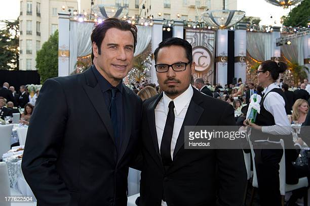 In this handout photo provided by Church of Scientology John Travolta and Michael Pena attend the Church of Scientology Celebrity Centre 44th...