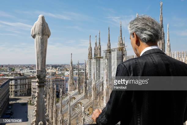In this handout photo provided by DECCA Records opera singer Andrea Bocelli looks on before his Easter concert at the Duomo on April 12 2020 in Milan...