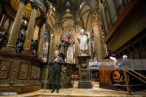 In this handout photo provided by DECCA Records opera singer Andrea Bocelli performs his Easter concert at the Duomo on April 12 2020 in Milan Italy...