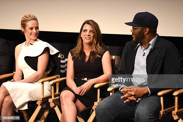 In this handout photo provided by Discovery Actress Danielle Savre President GM TLC Nancy Daniels and creator and producer Tyler Perry speak onstage...