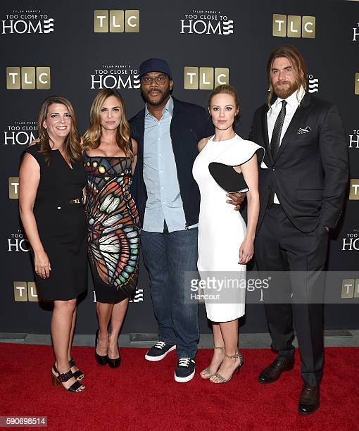 In this handout photo provided by Discovery President GM TLC Nancy Daniels actress Kelly Sullivan creator and producer Tyler Perry actors Danielle...