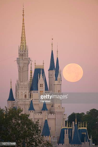 In this handout photo provided by Disney a full moon is seen over Cinderella Castle at Disney World on December 21 2010 in Lake Buena Vista Florida