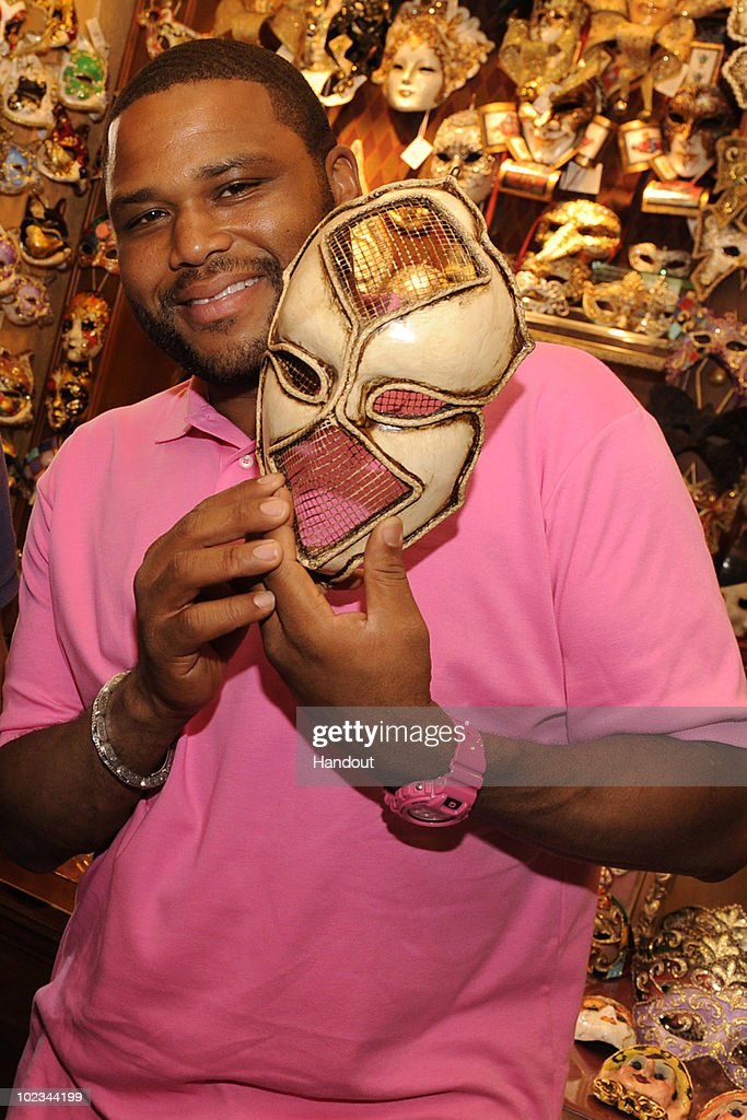 In this handout photo provided by Disney, actor Anthony Anderson checks out a handmade Venetian mask at the Italy pavilion at Epcot on June 21, 2010 in Lake Buena Vista, Florida. Anderson, who stars in the NBC series 'Law & Order,' is vacationing at the Walt Disney World Resort with family this week.