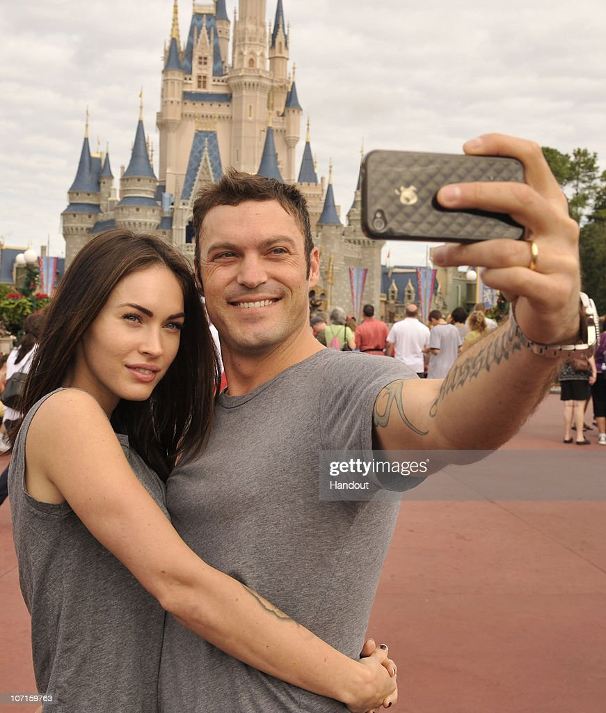 In this handout photo provided by Disney, actor Brian Austin Green (right) and his wife, actress/model Megan Fox (left), take a souvenir photo in the Magic Kingdom November 26, 2010 in Lake Buena Vista, Florida. Green ('Beverly Hills, 90210', 'Desperate Housewives') and Fox ('Transformers,' 'Transformers: Revenge of the Fallen') were married in June 2010 in Hawaii.