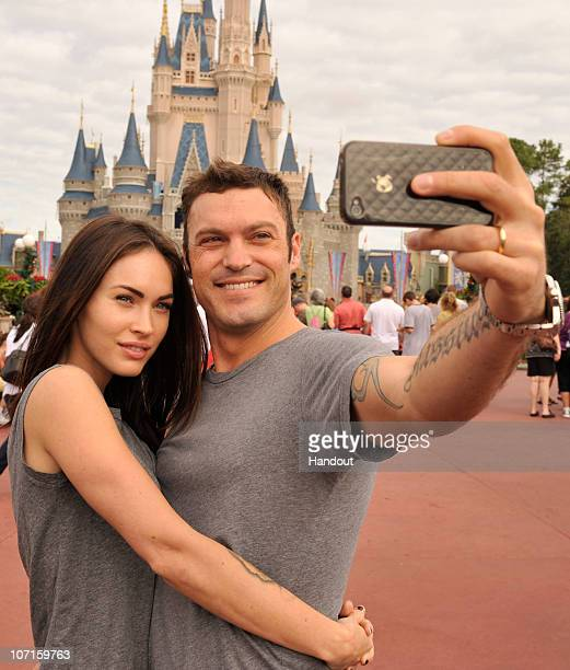 In this handout photo provided by Disney actor Brian Austin Green and his wife actress/model Megan Fox take a souvenir photo in the Magic Kingdom...