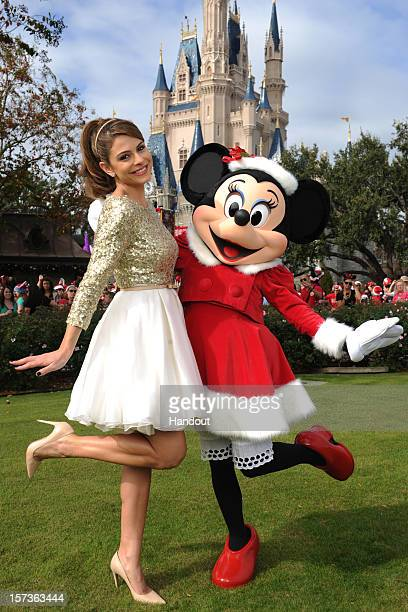 In this handout photo provided by Disney actress and entertainment journalist Maria Menounos poses with Minnie Mouse during a break in taping the...