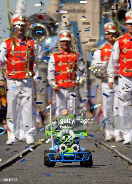 In this handout photo provided by Disney Amidst confetti and streamers a 12inchtall Buzz Lightyear toy receives a hero's welcome Oct 2 2009 at the...