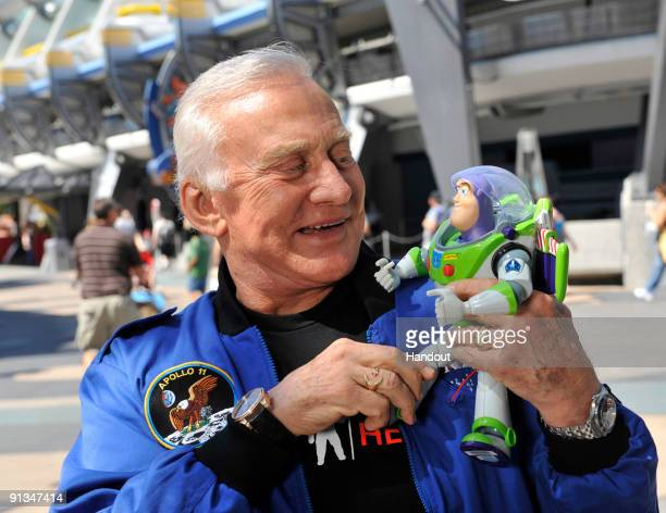 In this handout photo provided by Disney Apollo 11 astronaut Buzz Aldrin poses Oct 2 2009 at the Magic Kingdom in Lake Buena Vista Fla with the...