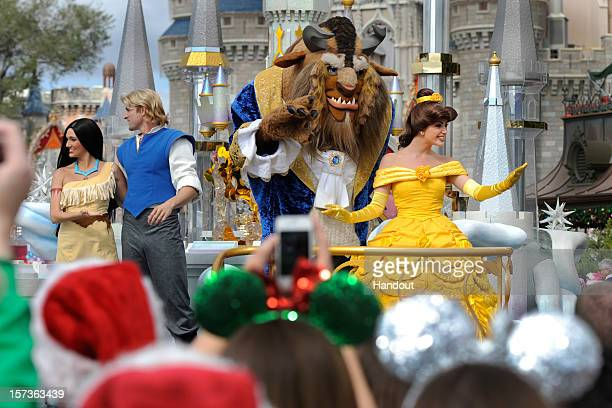 In this handout photo provided by Disney characters from Disney's classic animated films 'Pocahontas' and 'Beauty and the Beast' wave to the crowd...