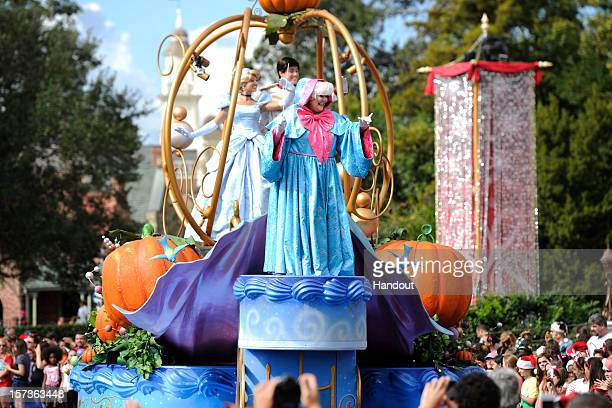 In this handout photo provided by Disney characters from Disney's classic animated film Cinderella wave to the crowd while taping the Disney Parks...